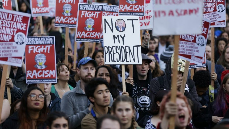 Americans march in protest of the 2016 election results